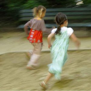 child-girls-running-blur-green