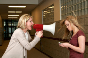 iStock megaphone shout at teen 000005586427XSmall