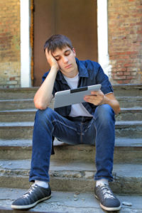 Sad Teenager with Tablet